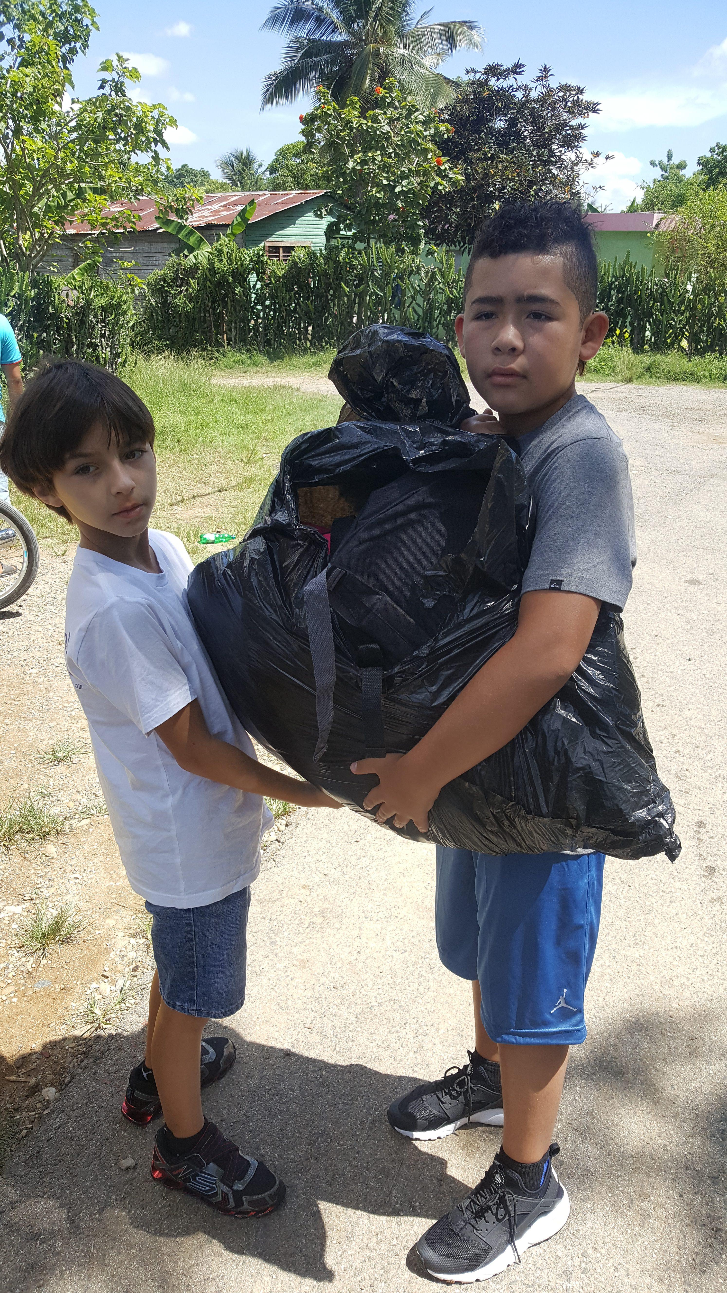 children holding bag