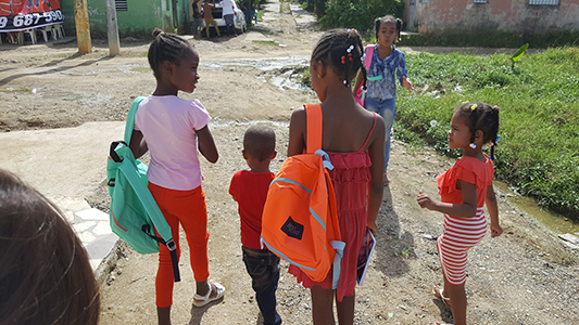 children with backpacks