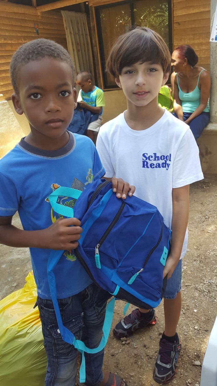 backpack held by kids