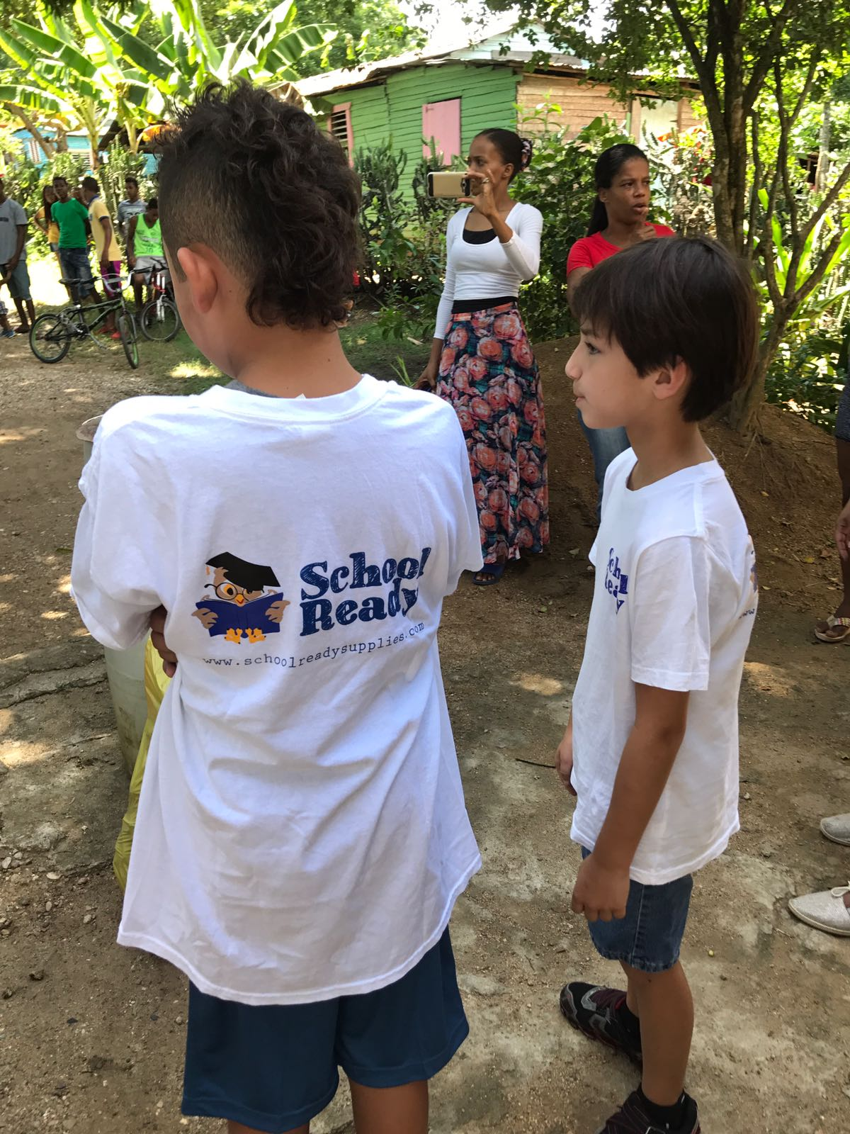 two children with school ready shirts