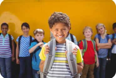 smiling child with backpack